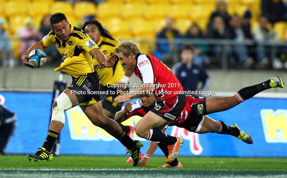 Hurricanes Alapati Leiua on the attack. Investec Super 15 rugby match - Hurricanes v Lions, at Westpac Stadium, Wellington, New Zealand on Saturday 4 June 2011. Photo: Justin Arthur / photosport.co.nz