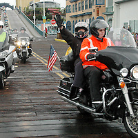 The Irish 66'ers , a group of 100 Irish motorcyclist, ride their Harley Davidsons down the Santa Monica Pier on Wednesday, October 06, 2010. The ride started in Chicago nine days ago. The Irish motorcyclists traveled 2,448 miles along the historic Route 66 to raise money for the Temple Street Children's University Hospita l. Since the first ever Route 66 Challenge in aid of Temple Street took place in 2002, the challenge has raised an incredible 1.5 million euro in much needed funds for the Hospital. .The Irish 66'ers , a group of 100 Irish motorcyclist, ride their Harley Davidsons down the Santa Monica Pier on Wednesday, October 06, 2010. The ride started in Chicago nine days ago. The Irish motorcyclists traveled 2,448 miles along the historic Route 66 to raise money for the Temple Street Children's University Hospita l. Since the first ever Route 66 Challenge in aid of Temple Street took place in 2002, the challenge has raised an incredible 1.5 million euro in much needed funds for the Hospital. .