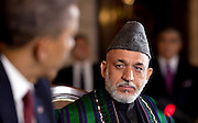 01.MAY.2012. KABUL<br /> <br /> AFGHAN PRESIDENT HAMID KARZAI LISTENS AS PRESIDENT BARACK OBAMA DELIVERS REMARKS DURING THE STRATEGIC PARTNERSHIP AGREEMENT SIGNING CEREMONY AT THE PRESIDENTIAL PALACE IN KABUL, AFGHANISTAN, MAY 1, 2012.  <br /> <br /> BYLINE: EDBIMAGEARCHIVE.CO.UK<br /> <br /> *THIS IMAGE IS STRICTLY FOR UK NEWSPAPERS AND MAGAZINES ONLY*<br /> *FOR WORLD WIDE SALES AND WEB USE PLEASE CONTACT EDBIMAGEARCHIVE - 0208 954 5968*