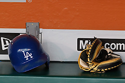SAN FRANCISCO, CA - MAY 20:  Detailed view of a Los Angeles Dodgers batting helmet and baseball glove in the dugout before the game against the San Francisco Giants at AT&T Park on May 20, 2015 in San Francisco, California.  The San Francisco Giants defeated the Los Angeles Dodgers 4-0. (Photo by Jason O. Watson/Getty Images) *** Local Caption ***