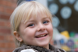 Happy little girl smiling,