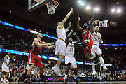 Feb. 11, 2011; Cleveland, OH, USA; Los Angeles Clippers point guard Baron Davis (5) shoots over Cleveland Cavaliers shooting guard Anthony Parker (18) during the fourth quarter at Quicken Loans Arena. The Cavaliers broke their loosing streak beating the Clipper 126-119 in overtime. Mandatory Credit: Jason Miller-US PRESSWIRE