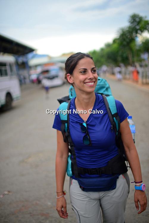 Young attractive female backpacker in Wellawaya bus station, Sri Lanka