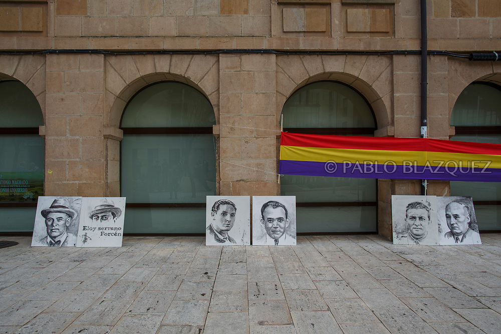 14/04/2018. Portraits depicting Spain's Civil war victims Francisco Romero Carrasco (L), Eloy Serrano Forcen (2L), Elicio Gomez (3L), Hipolito Olmo Fernandez (3R) and Victoriano Tarancon (2R) and Abundio Andaluz (R) exhumed in Cobertelada and Calata&ntilde;azor lean against a wall during a homage to hand the remains to their relatives on April 14, 2018 in Soria, Spain. La Asociacion Soriana Recuerdo y Dignidad (ASRD) 'The Soria Association for Memory and Dignity' celebrated a tribute to hand over the remains of civil war victims to their families. The Society of Sciences of ARANZADI helped with the research, exhumation and identification of the bodies, after villagers passed the information about the mass grave, 81 years after the assassination took place, to the ASRD. Seven people were assassinated around August 25, 1936 by Falangists, as part of General Francisco Franco armed forces, and buried in the 'Fosa de los Maestros' (Teachers Mass Grave) near Cobertelada, Soria, after being taken from prison of Almazan during the Spanish Civil War. Five of them were teachers in the region, and also friends of Spanish writer Antonio Machado. The other two still remain unidentified. Another body was assassinated by Falangists accompanied by a priest in 1936, and was exhumed on 23 September of 2017 near Calata&ntilde;azor, Soria. It belonged to Abundio Andaluz, a politician, lawyer and musician in Soria.<br /> Spain's Civil War took the lives of thousands of people on both sides, and civilians. But Franco continued his executions after the war has finished. Teachers, as part of the education sector, were often a target of Franco's forces. Spanish governments has never done anything to help the victims of the Civil War and Franco's dictatorship while there are still thousands of people missing in mass graves around the country. (&copy; Pablo Blazquez)