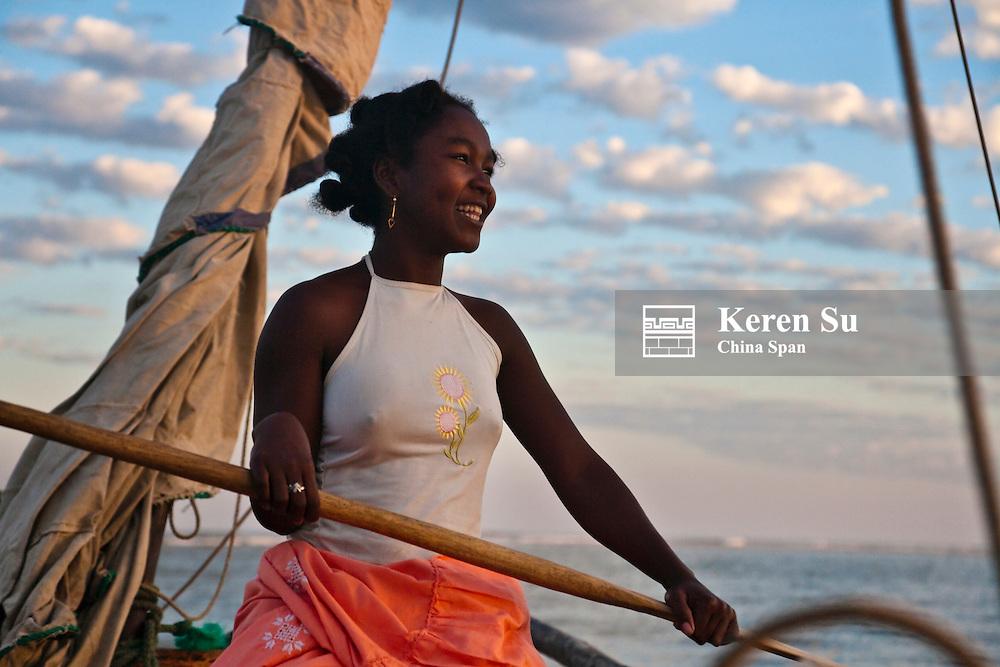 Girl on sail boat, Morondava, Madagascar