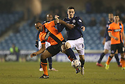 Chris O'Grady, Brighton striker and Midfielder Shaun Williams during the Sky Bet Championship match between Millwall and Brighton and Hove Albion at The Den, London, England on 17 March 2015.