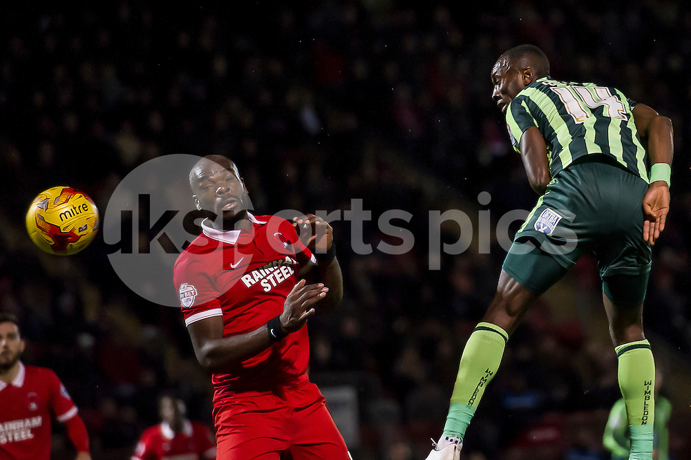 Adebayo Azeez of Wimbledon takes a shot at goal with a header during the Sky Bet League 2 match between Leyton Orient and AFC Wimbledon at the Matchroom Stadium, London, England on 28 November 2015. Photo by Salvio Calabrese.