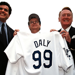 10-28-99-26-DALY#1--KEITH BIRMINGHAM--TRIB<br /> LOS ANGELES: The Los Angeles Dodgers held a press conference at the new Staples Center in Downtown Los Angeles to name Robert Daly,Center, former Warner Bros. head to become the managing Partner and acquire a minority stake in the Dodgers, Peter Chernin,left, President and Chief Operating Officer along with Vin Scully stand with Daly holding his new jersey.