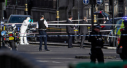 © Licensed to London News Pictures. 22/03/2017. London, UK. Police forensics examine a car (grey, pictured right) involved in the incident, at the scene of suspected terrorist attack near Houses of Parliament in Westminster, London. Photo credit: Ben Cawthra/LNP