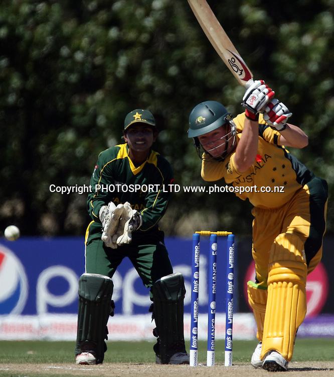 Australian Tim Armstrong drives. Pakistan Wicketkeeper is Mohammad Waqas. Australia v Pakistan, U19 Cricket World Cup Final, Bert Sutcliffe Oval, Lincoln, Christchurch, Saturday 30th January 2010. Photo : PHOTOSPORT