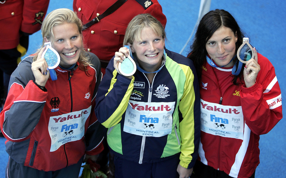 Australia's gold medalist Leisel Jones (C), Germany's silver medalist (L) Anne Poleska, and Austria's bronze medalist Mirna Jukica hold up their medals after the 200m Breaststroke victory stand ceremony at the FINA World Championships in Montreal, Canada, Friday 29 July 2005. Jones won the gold in world-record time of 2:21.72.