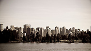 A view of the Vancouver skyline from the deck of a ship in English Bay, Canada.