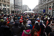 People wait in line to enter the parade route area during the inauguration ceremonies for Pres. Barack Obama on January 21, 2013 in Washington, D.C.