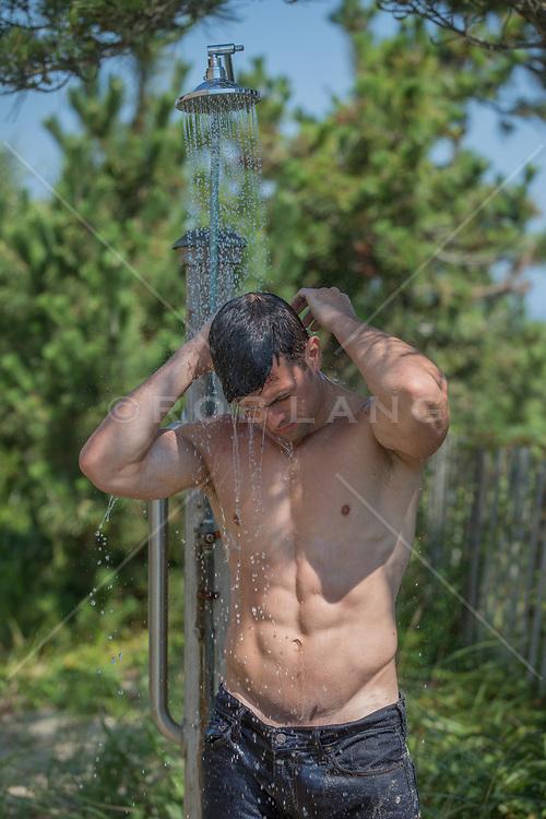hot shirtless man in an outdoor shower
