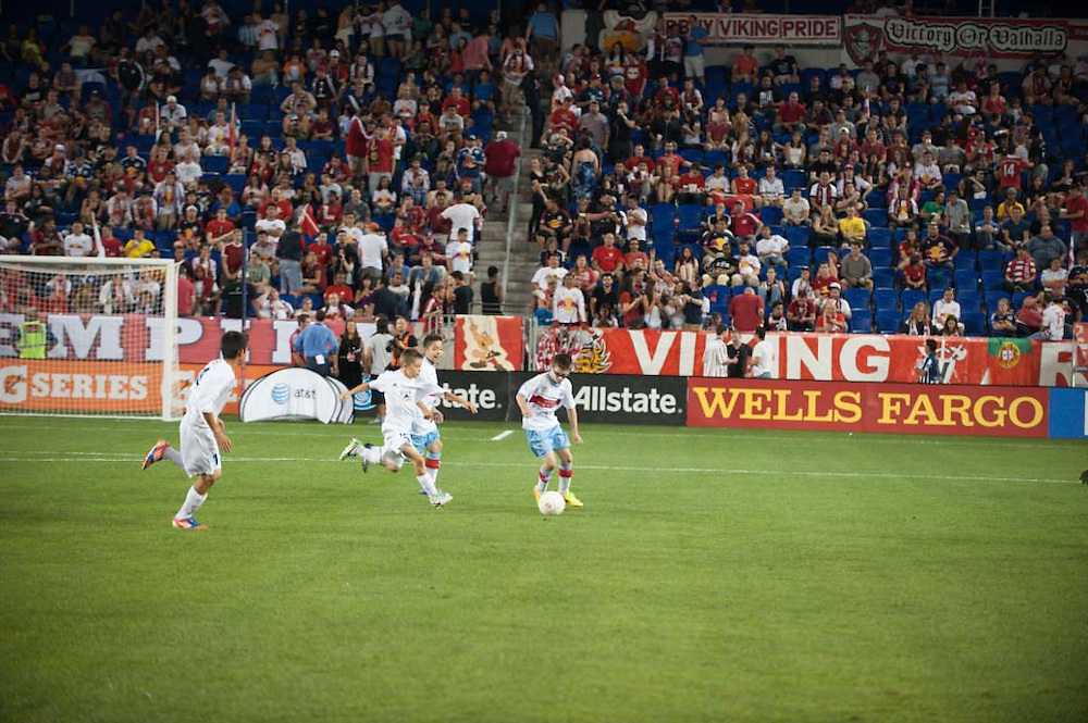 HARRISON, NJ - AUGUST 17:  Kids play at halftime during the game between the New York Red Bulls and the Philadelphia Union Halftime at Red Bulls Arena on August 17, 2013. (Photo By: Rob Tringali)