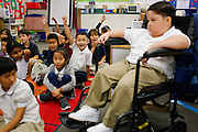"Classmates eagerly raise their hands when asked, ""Who wants to play with Noah?"" during Noah Stout's, 7, first visit to Hilary Leday's second grade class since being diagnosed with Diffuse Intrinsic Pontine Glioma (DIPG), a rare and non-operable tumor located on the brain stem, at Sinnott Elementary School in Milpitas, California, on August 29, 2013. (Stan Olszewski/SOSKIphoto)"