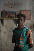 "September 12, 2015. I met Susheel few days ago when I was on assignment for an international foundation. I was shooting in Hosur, TN. He is from Faizabad in Uttar Pradesh and is working in a small auto product manufacturer. He didn't know his age, ""may be 21"" he said. He knew few Tamil words like 'sapaat' (food), 'tanni' (water)..etc."