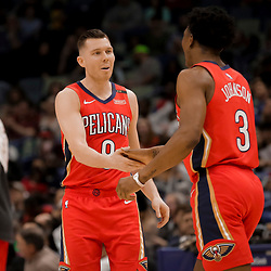 Apr 3, 2019; New Orleans, LA, USA;  New Orleans Pelicans guard Dairis Bertans (9) and forward Stanley Johnson (3) during the second half against the Charlotte Hornets at the Smoothie King Center. Mandatory Credit: Derick E. Hingle-USA TODAY Sports