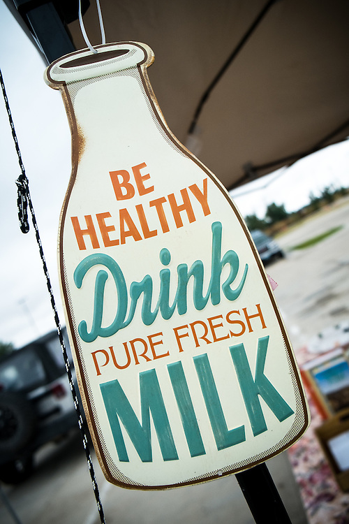 'Be Healthy Drink Pure Fresh Milk' sign at EZ Rocking Ranch's stand at the Gillette Farmer's Market | August 2014