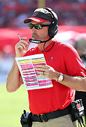 Nov 25, 2018; Tampa, FL, USA; Tampa Bay Buccaneers head coach Dirk Koetter calls a play against the San Francisco 49ers at Raymond James Stadium. The Buccaneers beat the 49ers 27-9. (Steve Jacobson/Image of Sport)
