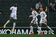 Benik Afobe of MK Dons (far left) celebrates scoring his sides third goal to make the scoreline 3-0 during the Sky Bet League 1 match between Milton Keynes Dons and Colchester United at stadium:mk, Milton Keynes<br /> Picture by Richard Blaxall/Focus Images Ltd +44 7853 364624<br /> 29/11/2014