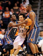 Feb. 4, 2012; Phoenix, AZ, USA; Charlotte Bobcats forward Boris Diaw (32) sets a pick on Phoenix Suns guard Steve Nash (13) for teammate guard Kemba Walker (1) during the second half at the US Airways Center.  The Suns defeated the Bobcats 95 - 89. Mandatory Credit: Jennifer Stewart-US PRESSWIRE.