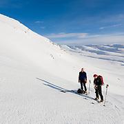 Jón Haukur Steingrímsson and Guðmundur Helgi Christensen skí touring at Botnsúlur mountains.