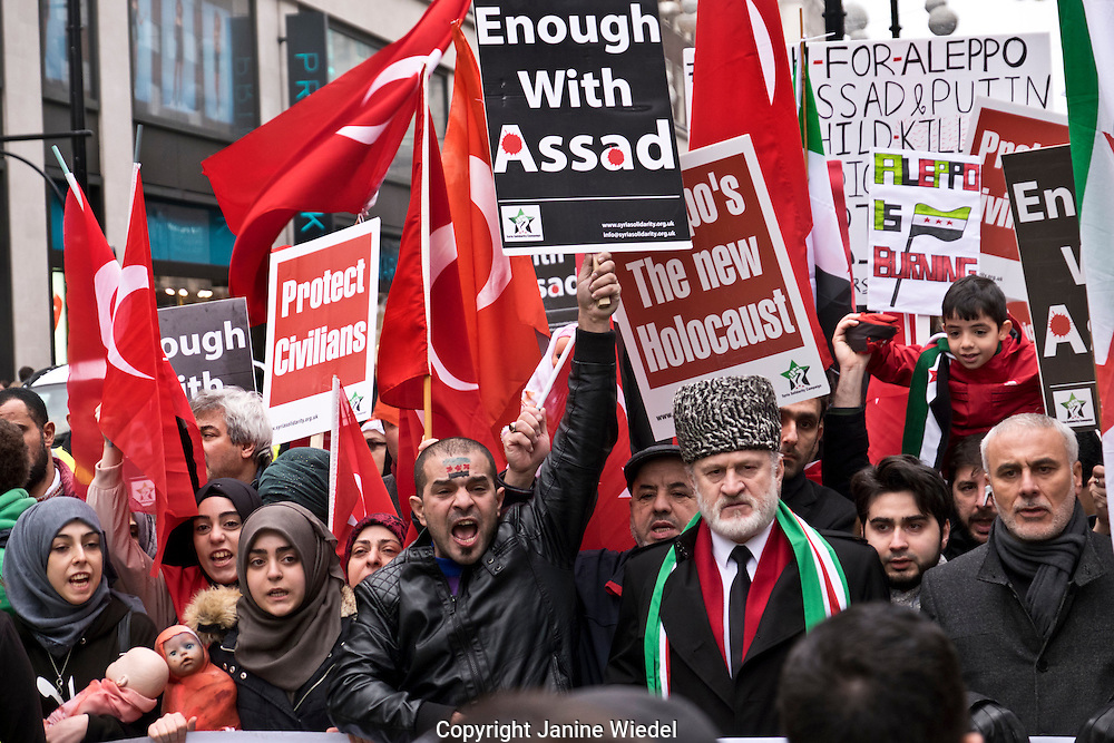 Syrians march to Downing Street calling for the West to do more to stop the genocide in Aleppo, London Dec17 2016