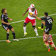 Nov 8, 2015; Harrison, NJ, USA; New York Red Bulls defender Ronald Zubar (23) heads the ball while being defended by D.C. United forward Jairo Arrieta (19) during the second half of the MLS Playoffs at Red Bull Arena. Mandatory Credit: William Hauser-USA TODAY Sports