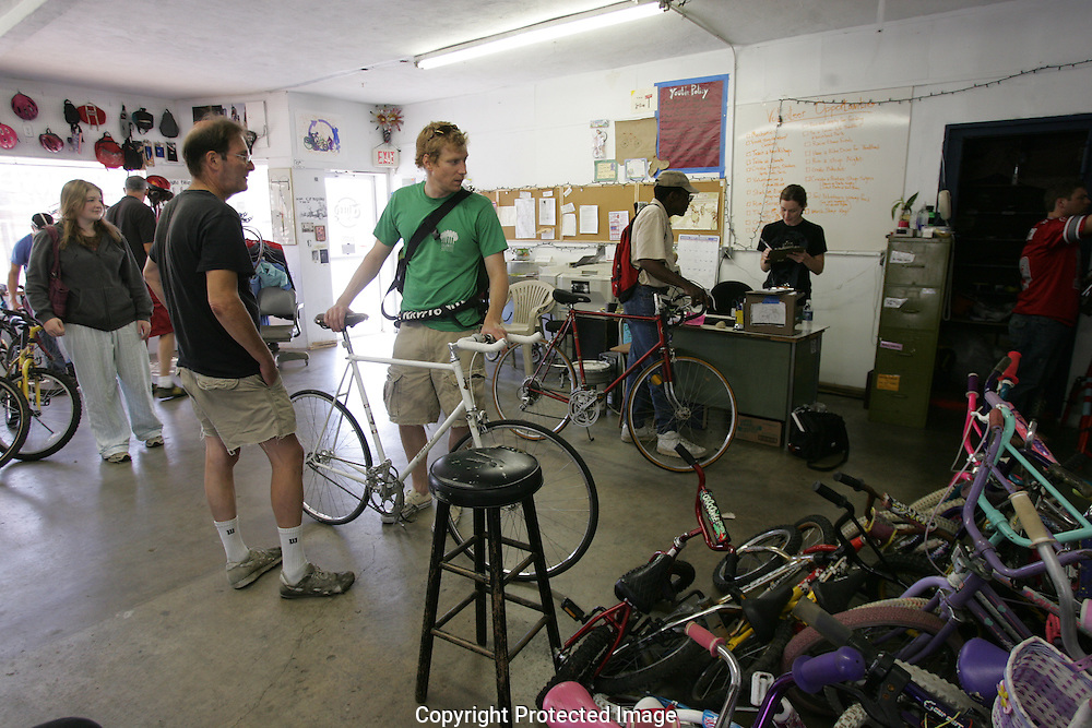 A busy Saturday afternoon at theThird Hand Bicycle Co-op..