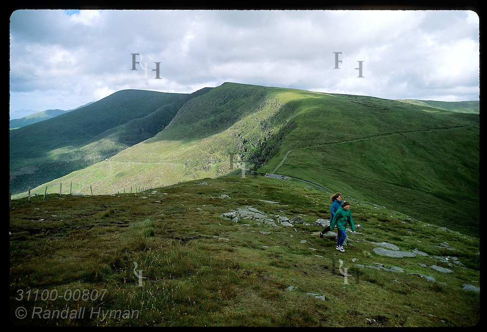 Girls run across field to overlook above Conor Pass, Ireland's highest (1500');Dingle Peninsula Ireland