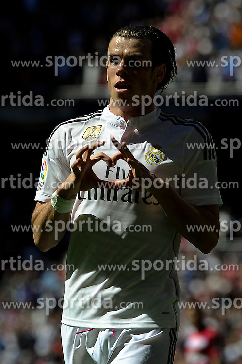 05.04.2015, Estadio Santiago Bernabeu, Madrid, ESP, Primera Division, Real Madrid vs FC Granada, 29. Runde, im Bild Real Madrid&acute;s Gareth Bale celebrates a goal // during the Spanish Primera Division 29th round match between Real Madrid CF and FC Granada at the Estadio Santiago Bernabeu in Madrid, Spain on 2015/04/05. EXPA Pictures &copy; 2015, PhotoCredit: EXPA/ Alterphotos/ Luis Fernandez<br /> <br /> *****ATTENTION - OUT of ESP, SUI*****