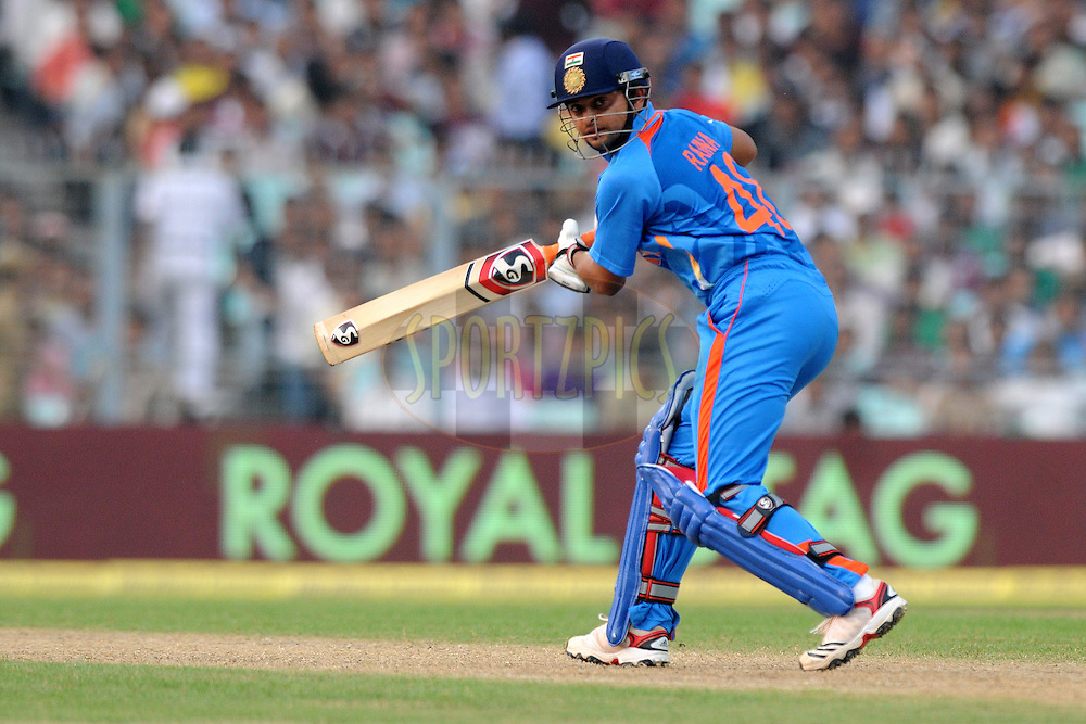 Suresh Raina of India bats during the 5th One Day International ( ODI ) match between India and England held at the Eden Gardens Stadium, Kolkata on the 23rd October 2011..Photo by Pal Pillai/BCCI/SPORTZPICS