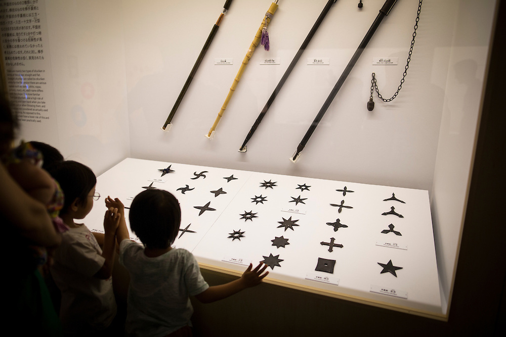"TOKYO, JAPAN - JULY 2 : A Japanese boy look at ninja's weapon on display during a ninja exhibition that kicks off Saturday at Miraikan in Tokyo, Japan on July 2, 2016. A special exhibition entitled ""The Ninja- who were they?"" will be open from July 2 (Saturday), 2016 to October 10 (Monday) 2016 at the Miraikan (National Museum of Emerging Science and Innovation). Photo: Richard Atrero de Guzman"