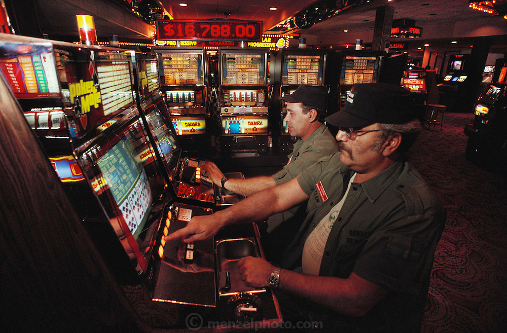 Sahara casino.  Attendees of the Soldier of Fortune Convention play slot machines, Las Vegas, Nevada, USA.