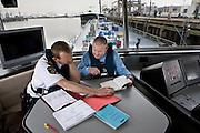 Het Aquapol team van de Zeehavenpolitie Rotterdam Rijnmond voert controles uit op schepen op 10 April, 2008 in Rotterdam, The Netherlands. Bij de controles wordt met name gecontroleerd op vervoer van  gevaarlijke stoffen en de benodigde papieren. (photo by Michel de Groot)