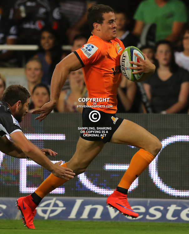 DURBAN, SOUTH AFRICA, 5, MARCH, 2016 - Emiliano Boffelli of the Jaguares is away from  Willie le Roux of the Cell C Sharks during The Cell C Sharks vs Jaguares Super Rugby match at Growthpoint Kings Park in Durban, South Africa. (Photo by Anesh Debiky)