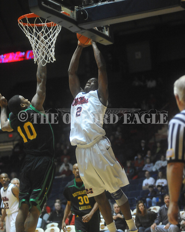 """Mississippi forward Reginald Buckner (2) dunks and is fouled by Southeastern Louisiana's Roosevet Johnson (10) at the C.M. """"Tad"""" Smith Coliseum in Oxford, Miss. on Sunday, January 2, 2011. (AP Photo/Oxford Eagle, Bruce Newman)"""