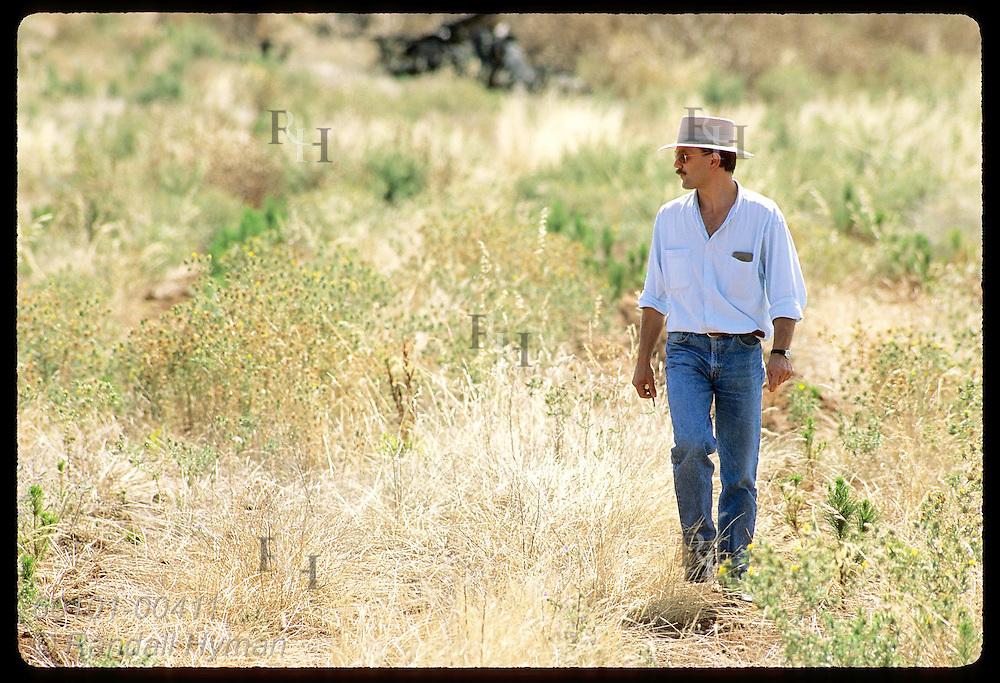 Zel Bodulovic, Yugoslavian immigrant, walks through bush of New South Wales, his adopted home. Australia