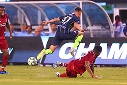 July 25, 2018 - East Rutherford, NJ, U.S. - EAST RUTHERFORD, NJ - JULY 25:  Manchester City midfielder Phil Foden (47) jumps over Liverpool defender Joe Gomez (12) during the first half of the International Champions Cup Soccer game between Liverpool and Manchester City on July 25, 2018 at Met Life Stadium in East Rutherford, NJ.  (Photo by Rich Graessle/Icon Sportswire) (Credit Image: © Rich Graessle/Icon SMI via ZUMA Press)