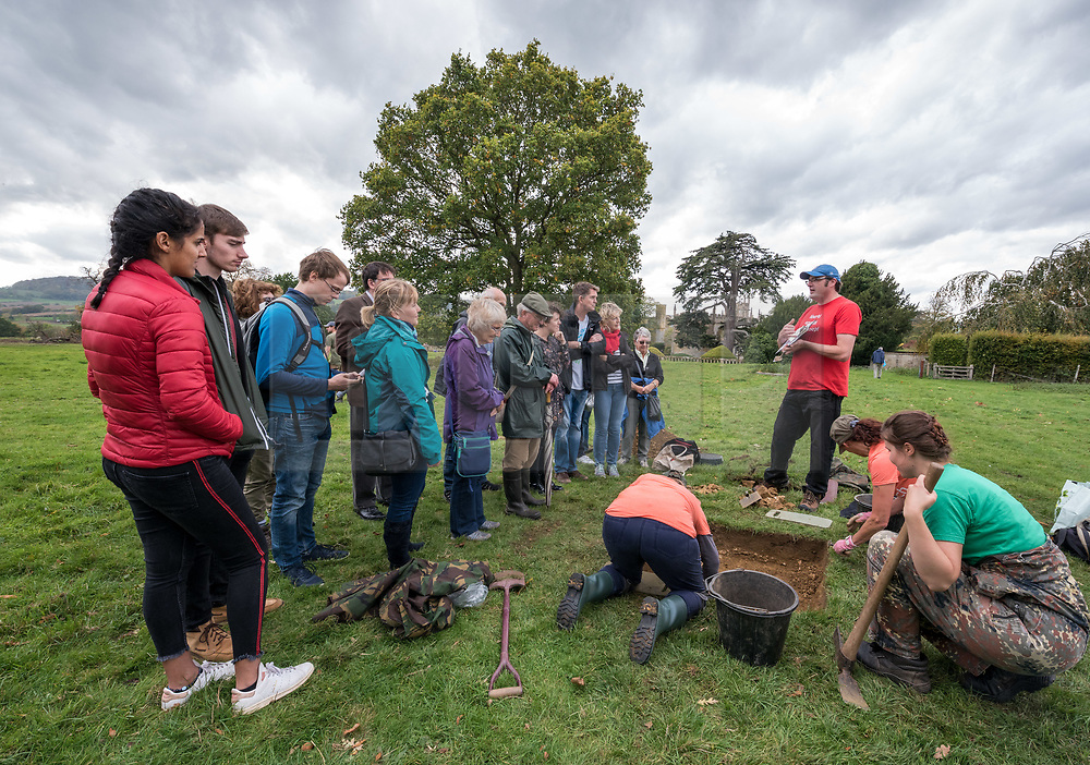 © Licensed to London News Pictures. 13/10/2018. Winchcombe, Gloucestershire, UK. Sudeley Castle. A tour for members of the public watches archaeologists from DigVentures working on site, hoping to unearth a long-lost Tudor garden at Sudeley Castle this weekend. Best-selling historical novelist Dr Philippa Gregory will also be joining the team. Philippa, who's well-known works include The Other Boleyn Girl and The White Queen, started her research into Sudeley Castle whilst working on a novel about Katherine Parr. For nearly 1,000 years, Sudeley Castle has hosted some of England's most famous monarchs including Henry VIII. It is also where Katherine Parr, Henry's last wife, later lived and was finally laid to rest. A recent geophysical survey at Sudeley revealed the ghostly outline of a long-lost Tudor garden, with traces of what could have been a banqueting house in the same area where pieces of Tudor masonry were found in the 19th century. Now experts say it is time to investigate further. The dig will take place at this Saturday and Sunday, October 13 and 14, and is thought to be the most significant archaeological investigation since the discovery of Roman villas on the estate in Victorian times. A specialist team from social archaeology company, DigVentures, will begin an investigation of the site, which aims to 'ground-truth' the geophysics results. They hope to reveal some of the Tudor secrets that remain hidden underground at the castle. Following the popular landscaping movement inspired by Capability Brown, many Tudor gardens were lost, and this is perhaps just one of only two in England where the original paths remain visible. Photo credit: Simon Chapman/LNP