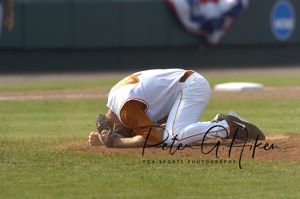 Texas closer J. Brent Cox celebrates after striking out Florida's Stephen Barton for the last out of the game.  Texas defeated Florida 6-2 for the National Championship at the College World Series at Rosenblatt Stadium in Omaha, Nebraska on June 26, 2005.