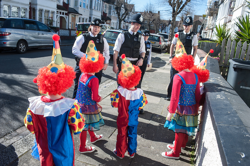 London, UK - 16 March 2014: Children of the Orthodox Jewish community of Stamford Hill talk to police officers during the festivity of Purim,