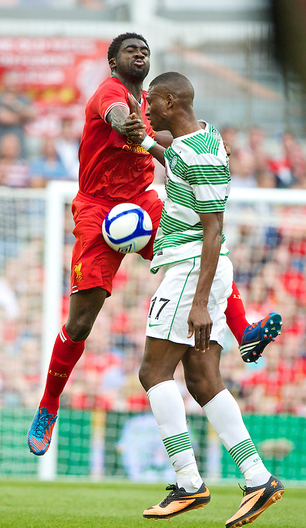 DUBLIN, REPUBLIC OF IRELAND - Saturday, August 10, 2013: Liverpool's Kolo Toure in action against Glasgow Celtic's Balde during a preseason friendly match at the Aviva Stadium. (Pic by David Rawcliffe/Propaganda)