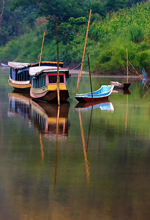 Boats at sunrise on the Nam Ou (river), Laos.