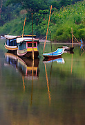 Boats at sunrise on the Nam Ou (river), Laos.