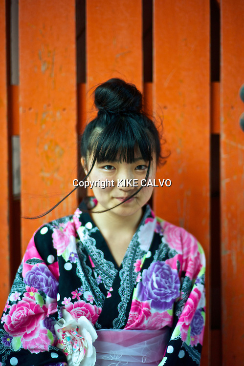 Portrait of an Asian teen wearing in traditional kimonos near the Kiyomizu Temple.