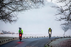 © Licensed to London News Pictures. 21/01/2020. London, UK. Cyclists in Richmond Park . A foggy start for commuters this morning in Richmond forecasters predict a mild and windy week ahead. Photo credit: Alex Lentati/LNP