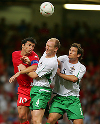 CARDIFF, WALES - Wednesday, September 8, 2004: Wales' captain Gary Speed in action against Northern Ireland's Colin Murdock (L) and Mark Williams during the Group Six World Cup Qualifier at the Millennium Stadium. (Pic by David Rawcliffe/Propaganda)