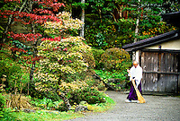 Monk raking up leaves, Nikko, Japan